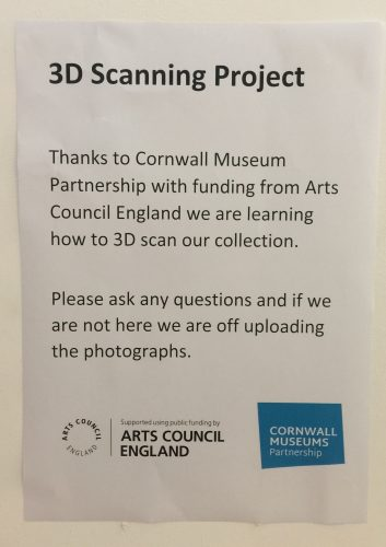 "Sign reading ""3D scanning project. Thanks to Cornwall Museum Partnership with funding from Arts Council England we are learning how to 3D scan our collection"""